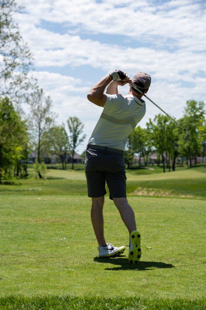 Club Golfer hitting golf ball
